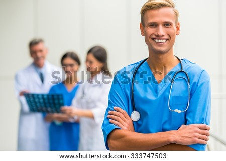 Modern medicine. Group successful doctors in hospital background
