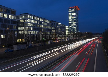 Modern office buildings in Munich, Germany, during the blue hour