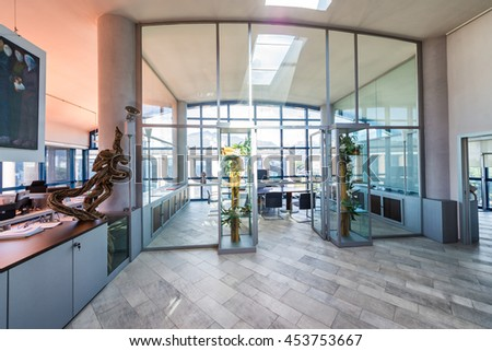 Modern office interior. Conference room and desktops. Corporate and business concept.
