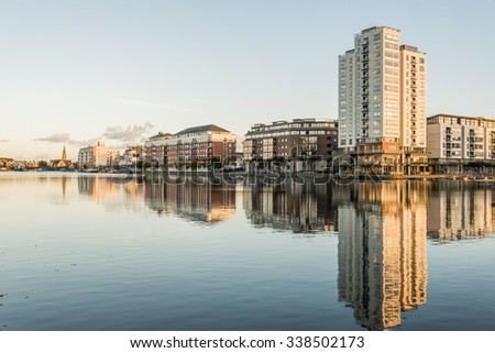Modern part of Dublin Docklands, known as Silicon Docks, in warm autumn evening.