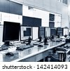 Modern plant control room and computer monitors - stock photo