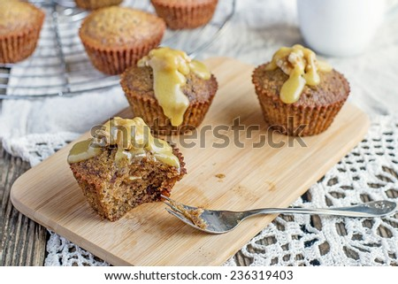 Moist muffins with dates and homemade toffee caramel. Selective focus