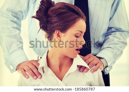 Molestation at work concept. Man molestating woman