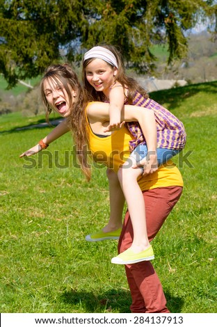 stock photo mom and daughter play in nature 284137913