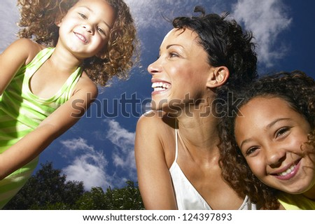 Mom and hers little girls smiling and having fun