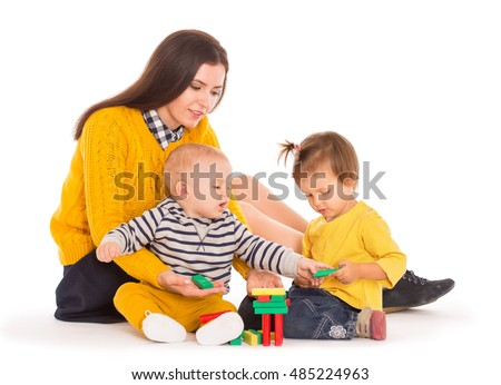 Mom and two kids playing with blocks