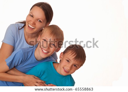 mom with her children on a light background