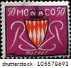 MONACO - CIRCA 1954: stamp printed in Monaco shows Grimaldi Arms, circa 1954 - stock photo