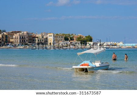 MONDELLO, SICILY, ITALY - September 26: end of season day at Mondello beach on September 26, 2014.