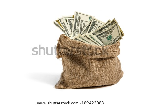 Money in the bag / studio photography of bag with hundred dollar bills
