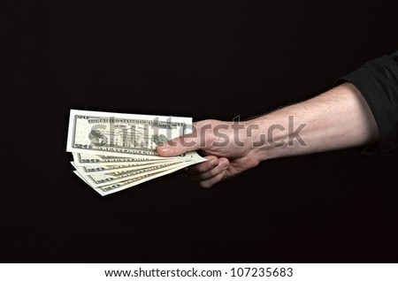 Money on the hands, isolated on black background