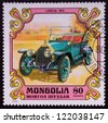 MONGOLIA - CIRCA 1980: A stamp printed in Mongolia shows a LANCIA 1911 old car, circa 1980. - stock photo