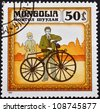 MONGOLIA - CIRCA 1982: stamp printed by Mongolia, shows Riding a Bicycle and Woman Looking at Him, circa 1982 - stock photo