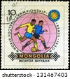 MONGOLIAN - CIRCA 1950: Stamp, printed in Mongolian showing world championship on football in Brazil, 1950, circa 1950. - stock photo