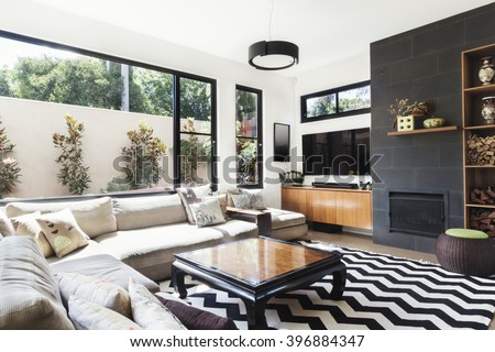chevron living room. Monochrome living room with wood and grey tiling accents chevron  pattern rug Living Room Wood Grey Tiling Stock Photo 396884347