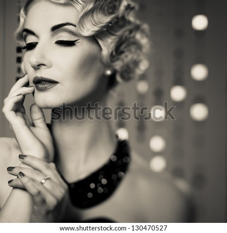 Monochrome portrait of elegant blond retro woman with beautiful hairdo