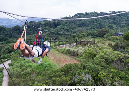 Monteverde, Costa Rica - May 29 : young adventurous man zip lining thru the cloud forest. May 29 2016, Monteverde, Costa Rica.