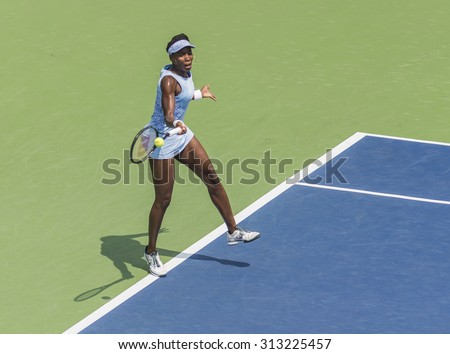 MONTREAL - AUGUST 10: Venus Williams of USA in her Final match loss to Agnieszka Radwanska of Poland at the 2014 Rogers Cup on August 10, 2014 in Montreal, Canada