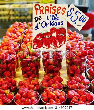 MONTREAL, CANADA -20 AUGUST 2015- Containers of fresh berries from Quebec for sale at the Marche Jean Talon farmers market in Montreal.