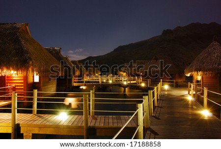 Moorea Bungalows over Lagoon at Night