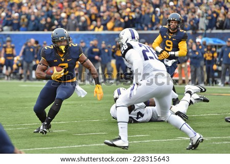 MORGANTOWN, WV - November 1: West Virginia Mountaineers running back Dreamius Smith (2) looks for running room on a carry during the Big 12 football game November 1, 2014 in Morgantown, WV.