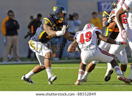 MORGANTOWN, WV - NOVEMBER 5: WVU defensive end Bruce Irvin (blue) rushes the passer during the football game between Louisville and WVU November 5, 2011 in Morgantown, WV.