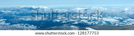 Morning misty winter mountain landscape with low-hanging clouds. View from the mount top  (Carpathian, Ukraine).