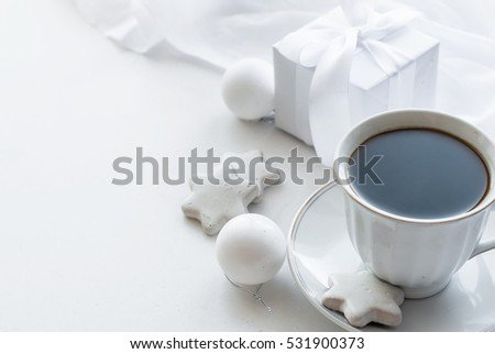 Morning white cup of coffee, biscuits Glazed  stars and Christmas balls,on the white background high key, copy space