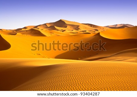 Moroccan desert landscape with blue sky. Dunes background.