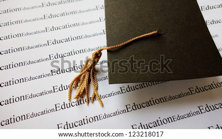 Mortar board, graduation cap on education text