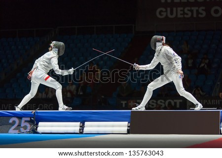 MOSCOW - APR 6: Start of fight on championship of world in fencing among juniors and cadets, in Sports Olympic complex, on April 6, 2012 in Moscow, Russia