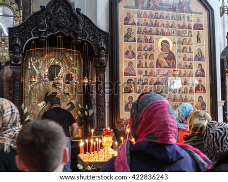 MOSCOW - APRIL 30, 2016: Unidentified people pray at the celebration of Orthodox Easter by the church of the Resurrection of Christ in Sokolniki.