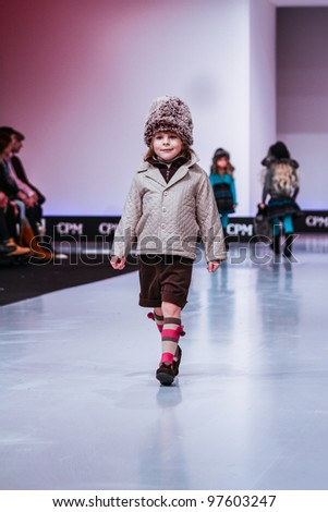MOSCOW-FEBRUARY 29: An unidentified child wears Condor clothing collection at the international exhibition of  the fashion industry, Collection Premiere Moscow, CPM on February 29, 2012 in Moscow, Russia.