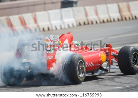MOSCOW - JULY 15: Giancarlo Fisichella of Scuderia Ferrari at Moscow City Racing 2012 at Kremlin embankment July 15, 2012 in Moscow