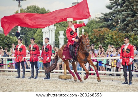 "MOSCOW - JULY 1, 2014: The Kremlin Equestrian Riding School at The ""Russian Traditions"" on July 1, 2014, at the VDNKh in Moscow"