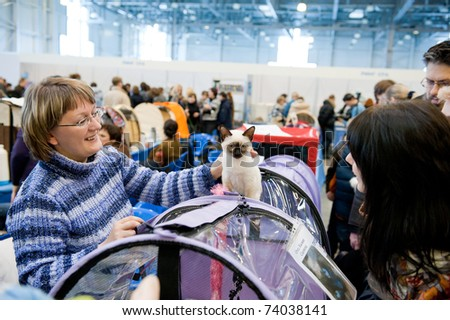 "MOSCOW - MARCH 6: Unidentified member of the exhibition shows his cat at international exhibition of cats ""Catsburg"" on March 6, 2011 in the exhibition hall Crocus-Expo, Moscow"