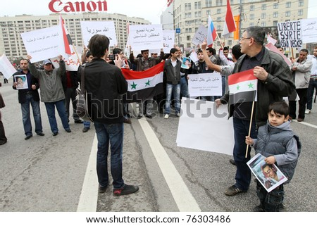 MOSCOW - MAY 1: Rally of representatives of Syrian community on Kaluzhskaya Square where communists gather before the Labor Day march in central Moscow, May 1, 2011 in Moscow, Russia. Unidentified people