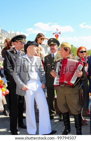 MOSCOW - MAY 09: The celebration of Victory Day in Moscow. Unidentified people on the street singing a retro song. The area near the Bolshoi Theater. May 9, 2011 in Moscow, Russia.