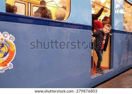 MOSCOW - MAY 5, 2015: Unidentified child looks vintage subway car at the exhibition of retro-cars dedicated to the 80th anniversary of the Moscow Metro. Public-event