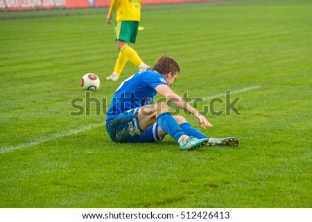 MOSCOW - OCTOBER 8, 2016: A player is injured on the soccer game Russian National Football League Dynamo (Moscow) vs Kuban (Krasnodar), the stadium Arena Khimki Moscow, Russia. Dinamo won 1: 0
