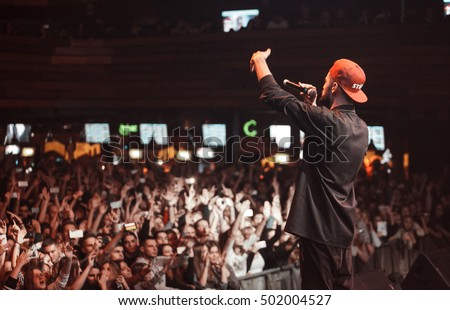 MOSCOW - 20 OCTOBER,2016 : Rap singer sing in crowded nightclub.Big live music show in night club.People have fun on concert.Big crowd on sold out festival