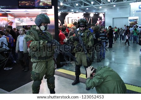 MOSCOW-October 7: Soldiers arrested the suspect at the international exhibition of interactive entertainment industry IgroMir on October 7, 2012 in Moscow