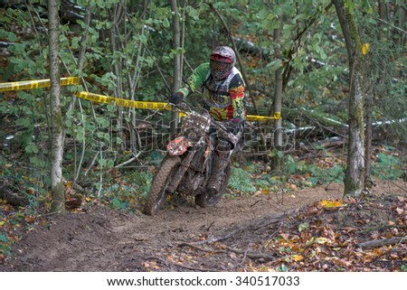 "MOSCOW-OCTOBER 10: Unidentified riders at the track, class ""MOTO"", in the 5 stage of the XSR-MOTO.RU Cross Country in Moscow, Park ""Velyaminovo""; on October 10, 2015"