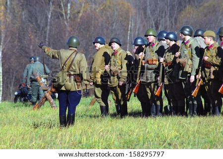 MOSCOW REGION - OCTOBER 13: A commander gives orders. Reenactors dressed as WW II soldier on October 13, 2013 in Borodino, Moscow Region, Russia. They reenact the Moscow Battle held in 1941.