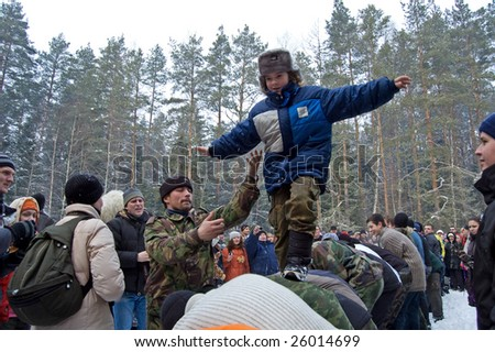 "MOSCOW REGION, RUSSIA - MAR 1: Russian pancake week - a seeing-off of winter. Traditional game ""The live bridge"" on March 1, 2009"