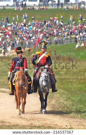 MOSCOW REGION - SEPTEMBER 07, 2014: Reenactors dressed as Napoleonic war soldiers stand at Borodino battle historical reenactment.
