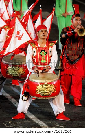 "MOSCOW, RUSSIA - AUGUST 31: Participants of the International Military Music Festival ""Spasskaya Tower"", the troupe from  She Huo Xi'an, China. August 31, 2011 on Red Square in Moscow, Russia"