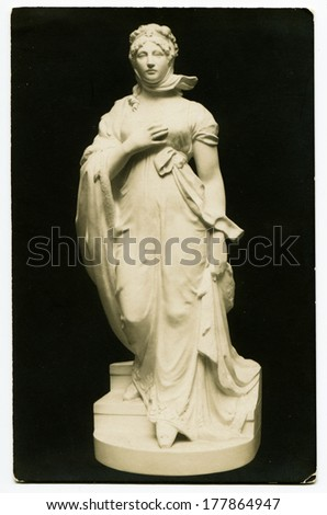 MOSCOW, RUSSIA - CIRCA 1900s: An antique photo shows an marble statue of a woman in a tunic