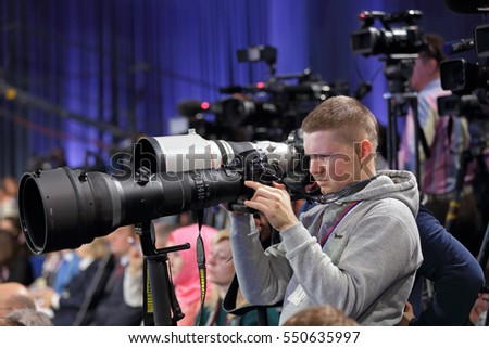 MOSCOW, RUSSIA - DEC 23, 2016: Press photographers of the annual press conference of the President of Russia Vladimir Putin in Center of international trade