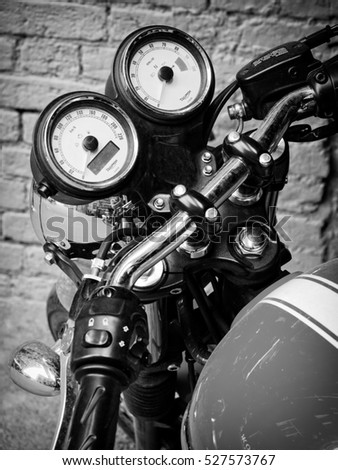 Moscow, Russia - June 18, 2016: Close-up of Triumph motorcycle dashboard black and white